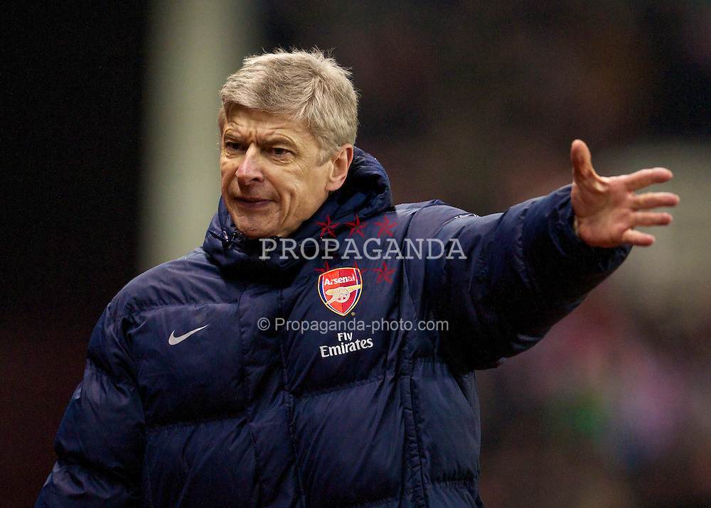 STOKE-ON-TRENT, ENGLAND - Saturday, February 27, 2010: Arsenal's manager Arsene Wenger against Stoke City during the FA Premier League match at the Britannia Stadium. (Photo by David Rawcliffe/Propaganda)