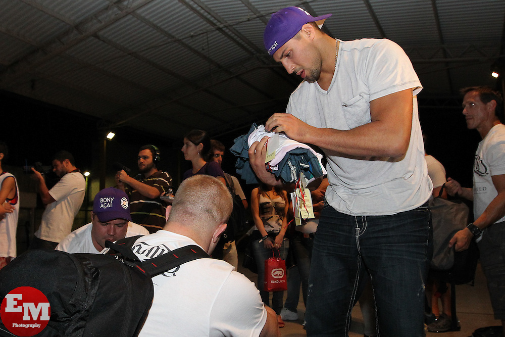 August 25, 2011; Rio De Janiero, Brazil; Brendan Schaub donates training gear to children in a Muy Thai school in a Favela.