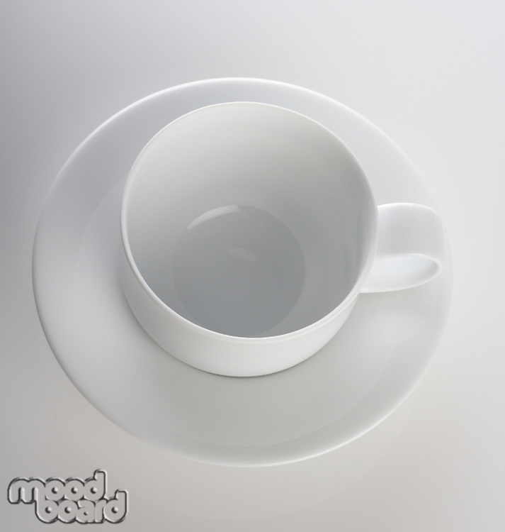 Empty cup on white background - studio shot