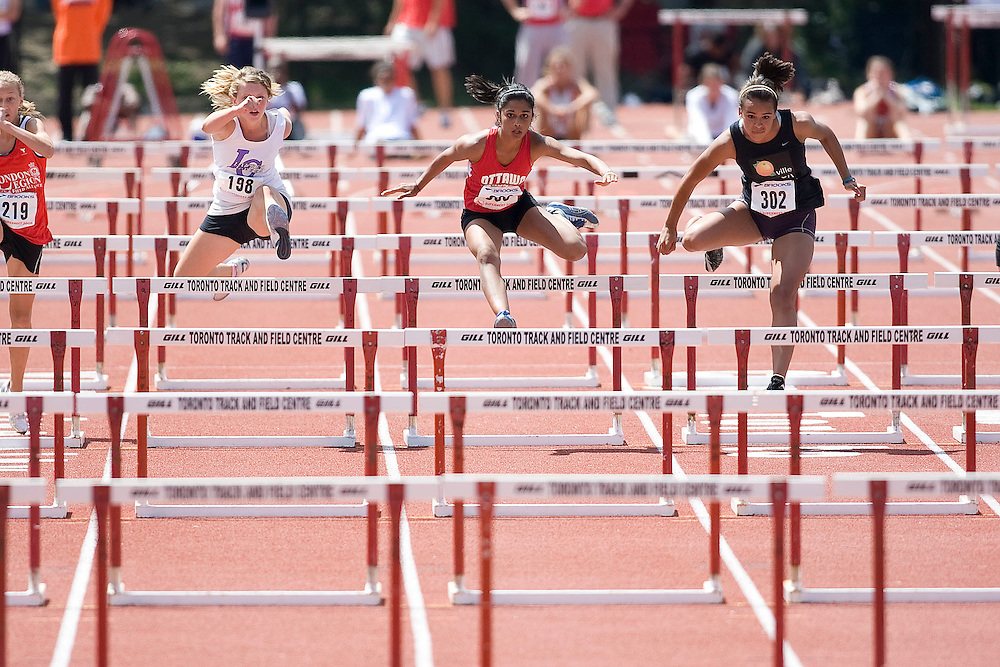 (Toronto, Ontario---3 August 2008)  Alexandra Rudow (198),  Devyani Biswal (306), and  Breanna Atkinson (302)\ competing in the midget girls 80m hurdles final at the 2008 OTFA Supermeet II, the Bantam, Midget, Youth Track and Field Championships. This image is copyright Sean W. Burges, and the photographer can be contacted at www.msievents.com.