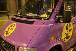 "© Licensed to London News Pictures . 13/02/2014 . Manchester , UK . The UKIP battle bus parked on a taxi rank outside the venue is given a parking ticket . Manchester City Council's former parking chief Nigel Murphy was reported by the Manchester Evening News as having said , "" We recommend to all people not to park in taxi ranks. We look forward to receive their payment "" . The count for the Wythenshawe and Sale East by-election , at Manchester Central this evening . Photo credit : Joel Goodman/LNP"