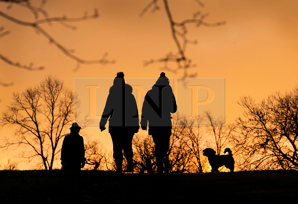 © Licensed to London News Pictures. 21/01/2019. London, UK. People walk across frozen ground in Greenwich Park at dawn. Photo credit: Peter Macdiarmid/LNP