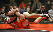 Linn-Mar's Shea Hartzler (from left) tries to turn Prairie's Nick Hogan during the 170-pound bout of the dual between Linn-Mar and Cedar Rapids Prairie at Prairie High School in Cedar Rapids on December 12, 2013.