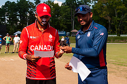 September 22, 2018 - Morrisville, North Carolina, US - Sept. 22, 2018 - Morrisville N.C., USA - MOHAMMED KHALEEL, Team USA captain, right, presents NITISH KUMAR, Team Canada captain, with an American Bald Eagle statue before their ICC World T20 America's ''A'' Qualifier cricket match between USA and Canada. Both teams played to a 140/8 tie with Canada winning the Super Over for the overall win. In addition to USA and Canada, the ICC World T20 America's ''A'' Qualifier also features Belize and Panama in the six-day tournament that ends Sept. 26. (Credit Image: © Timothy L. Hale/ZUMA Wire)
