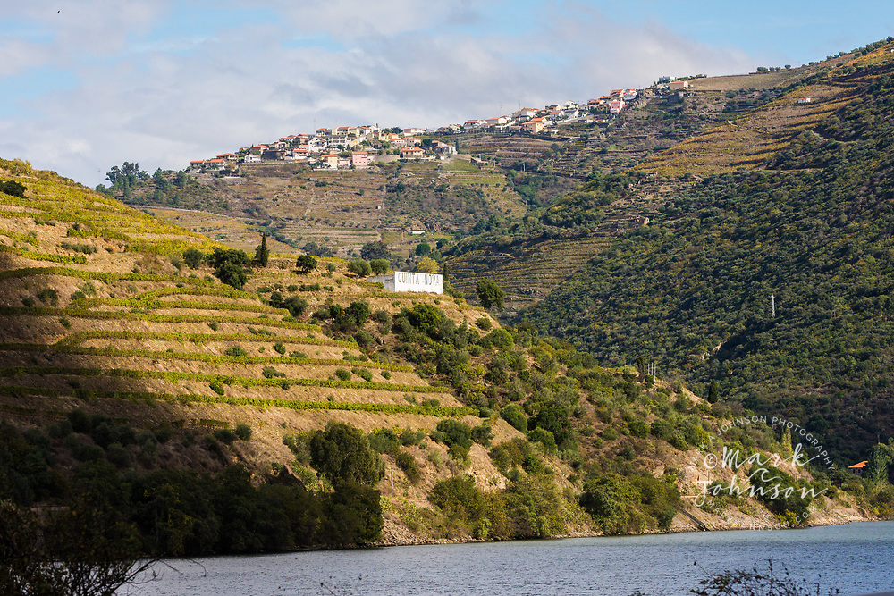 The hilltop village of Valença do Douro and the steeply terraced hillside vineyards of the Douro Valley, Portugal