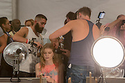 A model having her hair styled prior to the Custon Barcelona Spring 2013 Fashion Week show in New York.