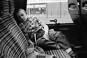Neville Asleep on Coach, High Wycombe, UK. 1980s.
