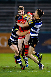 Bristol United Full Back Auguy Slowik is tackled by Bath United Outside Centre Max Clark and Winger Liam Forsyth - Mandatory byline: Rogan Thomson/JMP - 28/12/2015 - RUGBY UNION - The Recreation Ground - Bath, England - Bath United v Bristol United - Aviva A League.