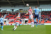 Doncaster Rovers No Andy Williams And Coventrys No 15 Jack Stephens during the Sky Bet League 1 match between Doncaster Rovers and Coventry City at the Keepmoat Stadium, Doncaster, England on 23 April 2016. Photo by Stephen Connor.