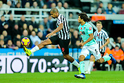 Jose Salomon Rondon (#9) of Newcastle United controls a long pass over the Bournemouth defense as he is put under pressure by Nathan Ake (#5) of Bournemouth during the Premier League match between Newcastle United and Bournemouth at St. James's Park, Newcastle, England on 10 November 2018.