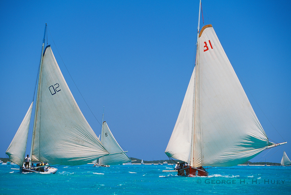 "356204-1192 ~ Copyright: George H. H. Huey ~ Traditional Class""A"" Bahamian sloops ""Red Stripe"" and ""New Courageous"" race towards the finish line. Annual National Family Island Regatta. George Town, Great Exuma Island, Bahamas."