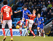Gillingham defender Aaron Morris and Swindon midfielder Lee Marshall fight for the ball during the Sky Bet League 1 match between Gillingham and Swindon Town at the MEMS Priestfield Stadium, Gillingham, England on 6 February 2016. Photo by David Charbit.