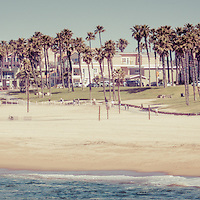 Huntington Beach vintage panorama photo. Panoramic picture ratio is 1:3 and has a retro nostalgic tone. Huntington Beach is also known as Surf City USA and is a seaside beach city along the Pacific Ocean in Orange County Southern California.