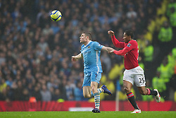 MANCHESTER, ENGLAND - Sunday, January 8, 2012: Manchester City's James Milner in action against Manchester United's Antonio Valencia during the FA Cup 3rd Round match at the City of Manchester Stadium. (Pic by Vegard Grott/Propaganda)