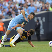 Damien Perrinelle, (right), New York Red Bulls, received a yellow card for this challenge on RJ Allen, NYCFC, during the New York City FC Vs New York Red Bulls, MSL regular season football match at Yankee Stadium, The Bronx, New York,  USA. 28th June 2015. Photo Tim Clayton