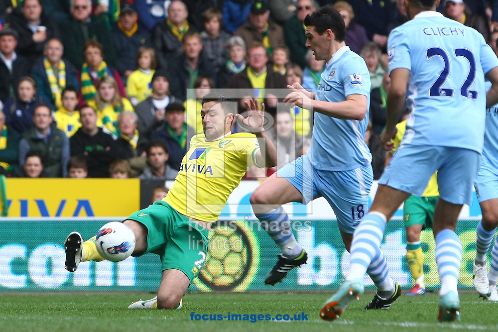 Picture by Paul Chesterton/Focus Images Ltd.  07904 640267.14/04/12.Russell Martin of Norwich gets his cross in during the Barclays Premier League match at Carrow Road Stadium, Norwich.