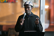 Faziri Ndahiro, a refugee from the Democratic Republic of the Congo, speaks at a rally at Spot Coffee, organized by Rochester Circle for Peace, in Rochester on Sunday, January 8, 2017.