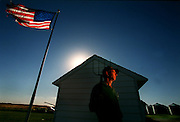 Keith Sexton, stands on his farm in Rockwell City, Iowa. Sexton is a Iowa farmer who switched from biotech seeds to conventional because he says he's in business to satisfy the customer, and customers don't want biotech food.