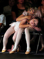 new port richey,fl.-  Leanna Julian,5, left and Brittany Farrell,9, right watch a performance during the 3rd Annual Renaissance Academy commencement exercises Thursday at the school. The students also performed during the commencement. (staff/scott iskowitz)