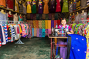 02 MARCH 2014 - MYAWADDY, KAYIN, MYANMAR (BURMA):  A dress maker works in her shop in the market in Myawaddy, Myanmar. Myawaddy is separated from the Thai border town of Mae Sot by the Moei River. Myawaddy is the most important trading point between Myanmar (Burma) and Thailand.      PHOTO BY JACK KURTZ