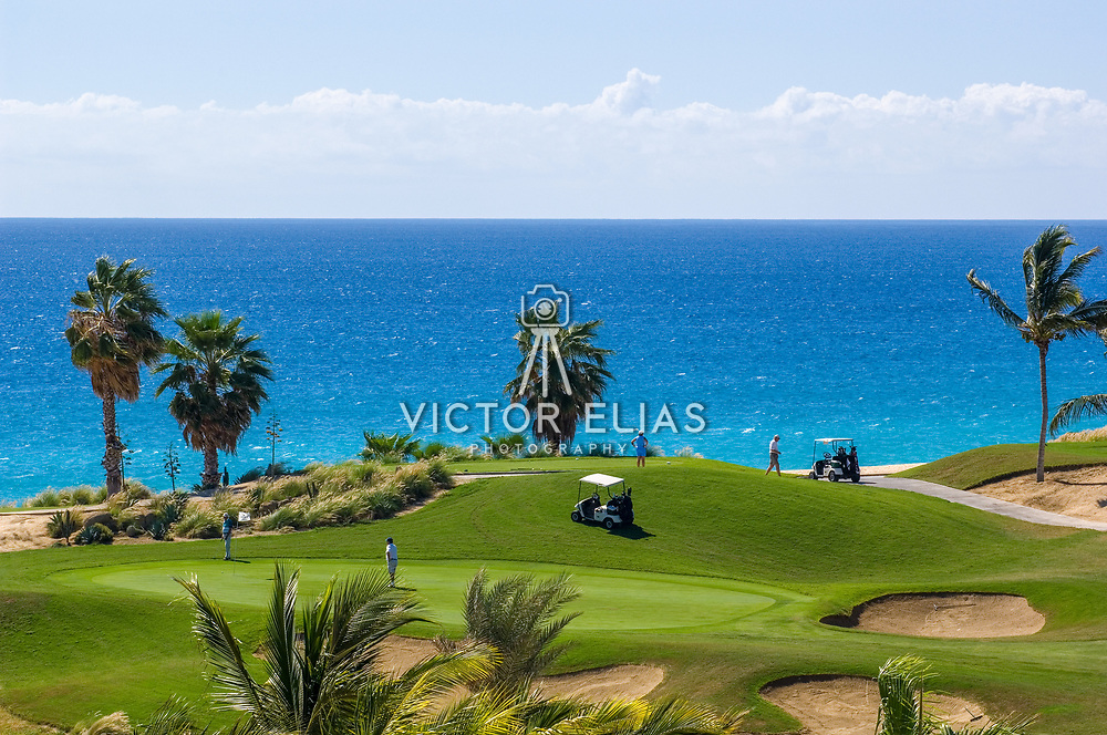 People playing golf at Cabo Real golf course. Los Cabos, BCS. Mexico.