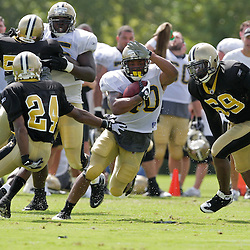 01 August 2009: New Orleans Saints running back Herb Donaldson (40) runs between defenders Leigh Torrence (24) and Anthony Hargrove (69) during New Orleans Saints training camp at the team's practice facility in Metairie, Louisiana.