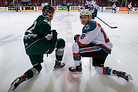 KELOWNA, CANADA - FEBRUARY 15:  \Justyn Gurney #22 of the Everett Silvertips catches up with Michael Farren #16 of the Kelowna Rockets during warmup on February 15, 2019 at Prospera Place in Kelowna, British Columbia, Canada.  (Photo by Marissa Baecker/Shoot the Breeze)