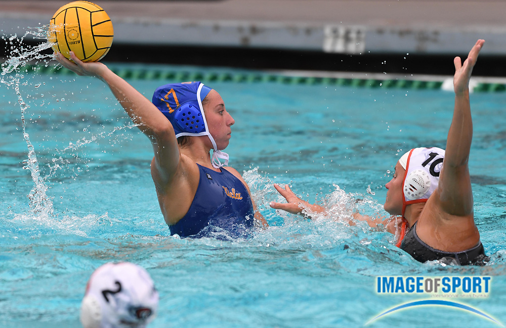 UCLA Bruins attacker Myna Simmons (17) is defended by Pacific Tigers attacker Viktoria Szmodics (10) during an NCAA college women's water polo quarterfinal game in Los Angeles, Friday, May 11, 2018. UCLA defeated Pacific, 8-4.