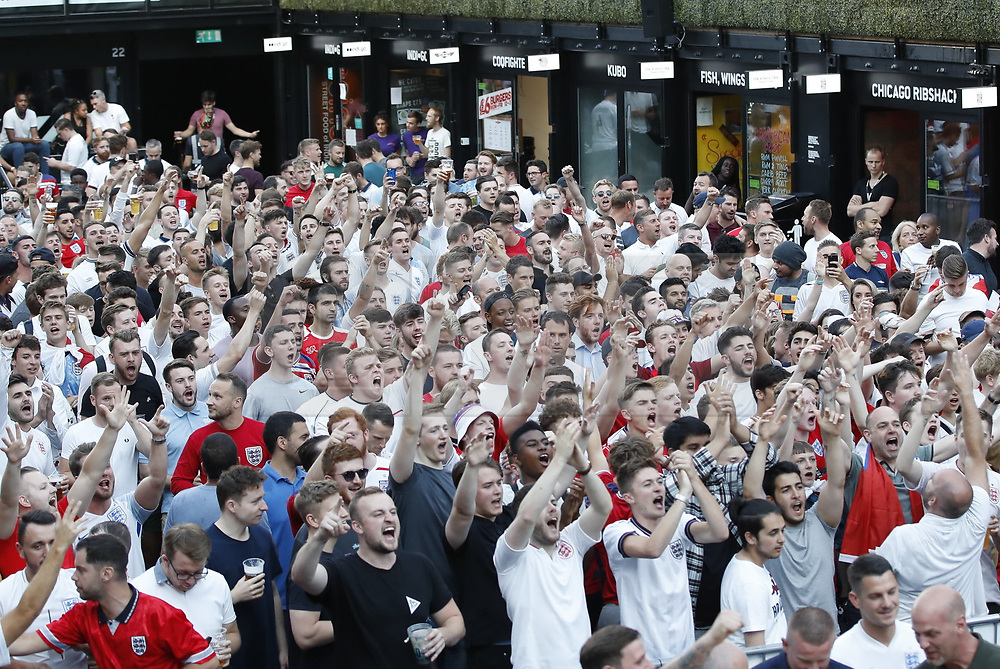 © Licensed to London News Pictures. 03/07/2018. London, UK. England football fans react to the England v Colombia game from the Russian World Cup on a big screen at Boxpark Croydon. Photo credit: Peter Macdiarmid/LNP