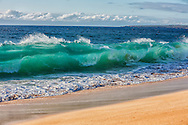 Aqua Crush - Big wave curling onto Papohaku Beach on Molokai, Hawaii