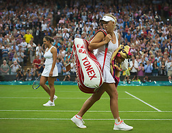 LONDON, ENGLAND - Wednesday, June 27, 2012: Caroline Wozniacki (DEN) looks dejected as she loses the Ladies' Singles 1st Round match to Tamira Paszek (AUT) on day three of the Wimbledon Lawn Tennis Championships at the All England Lawn Tennis and Croquet Club. (Pic by David Rawcliffe/Propaganda)