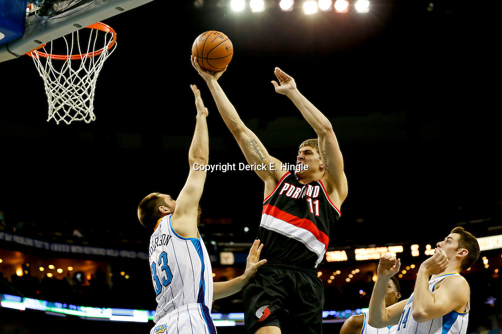 Feb 13, 2013; New Orleans, LA, USA; Portland Trail Blazers center Meyers Leonard (11) shoots over New Orleans Hornets power forward Ryan Anderson (33) during the second half of a game at the New Orleans Arena. The Hornets defeated the Trail Blazer 99-63. Mandatory Credit: Derick E. Hingle-USA TODAY Sports