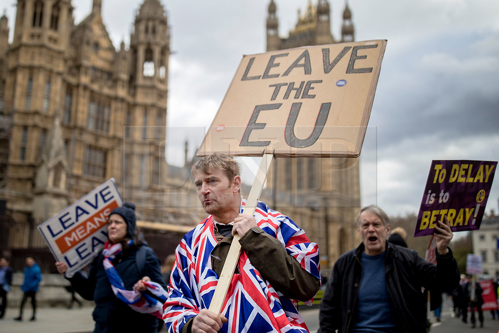 """© Licensed to London News Pictures. 13/03/2019. London, UK. Pro-Brexit protesters march through Westminster as MPs continue to debate a series of key votes on Brexit. MPs will vote on whether to remove the option of a """"no deal"""" departure from the EU today, after Prine Minister Theresa May's proposed deal was defeated for a second time last night. Photo credit: Rob Pinney/LNP"""