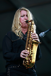 27 April 2013. New Orleans, Louisiana,  USA. .New Orleans Jazz and Heritage Festival. Grace Darling, saxophonist and singer  joins Allen Toussaint on the Acura stage. .Photo; Charlie Varley.