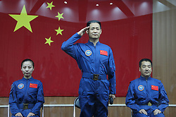 59797597 <br /> The three astronauts of the Shenzhou-10 manned spacecraft mission, Nie Haisheng (C), Zhang Xiaoguang (R) and Wang Yaping, meet the media at the Jiuquan Satellite Launch Center in Jiuquan, northwest China s Gansu Province, June 10, 2013. The Shenzhou-10 manned spacecraft will be launched at the Jiuquan Satellite Launch Center at 5:38 p.m. Beijing Time (0938 GMT) June 11.<br /> UK ONLY