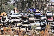Car scrapyard. Cars piled up in a scrapyard. Photographed in Beer Sheva Israel