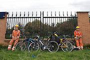 Contruction workers take a rest along the Alameda El Porvenir bike line - Bogota - Colombia