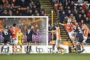Blackpool's Tom Aldred (15) clears his lines during the The FA Cup 3rd round match between Blackpool and Barnsley at Bloomfield Road, Blackpool, England on 7 January 2017. Photo by Craig Galloway.