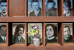 Photographs of those killed while attempting to flee East Berlin at Berlin Wall Memorial on Bernauer Strasse , Berlin, Germany. The Gedenkstätte Berliner Mauer commemorates the division of Berlin by the Berlin Wall and the deaths that occurred there. The monument was created in 1998 by the Federal Republic of Germany and the Federal State of Berlin.