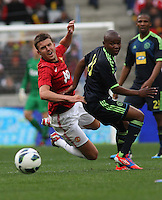 Manchester United's Michael Carrick against Paul Rusike during their International friendly match at Cape Town Stadium,South Africa