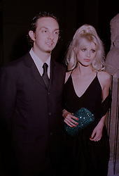 MR JOSHUA WOOD and model LAURA BAILEY at an exhibition in London on 1st October 1997.MBU 104