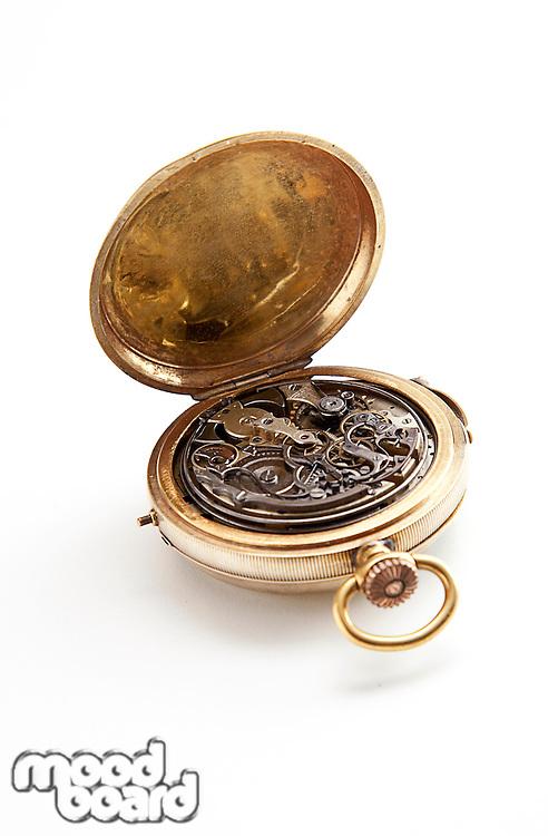 Clockwork inside pocket stopwatch over white background