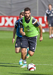 NEWPORT, WALES - Wednesday, October 8, 2014: Wales' Joe Ledley training at Dragon Park National Football Development Centre ahead of the UEFA Euro 2016 qualifying match against Bosnia and Herzegovina. (Pic by David Rawcliffe/Propaganda)