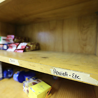 Many of the shelves in the food pantry at the Salvation Army are empty or low.
