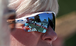 The match between Maria Sharapova and Natalia Vikhlyantseva is reflected in a spectators glasses during day one of the Aspall Classic at the Hurlingham Club, London.