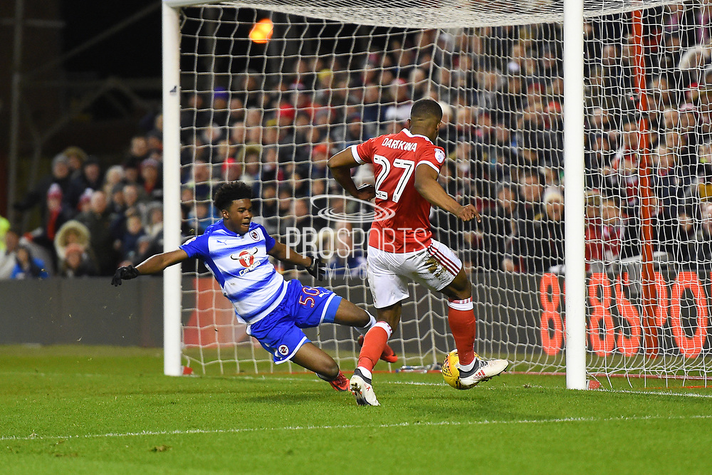 Reading's Omar Richards (50) tackles Nottingham Forest defender Tendayi Darikwa (27) and clears the ball during the EFL Sky Bet Championship match between Nottingham Forest and Reading at the City Ground, Nottingham, England on 20 February 2018. Picture by Jon Hobley.