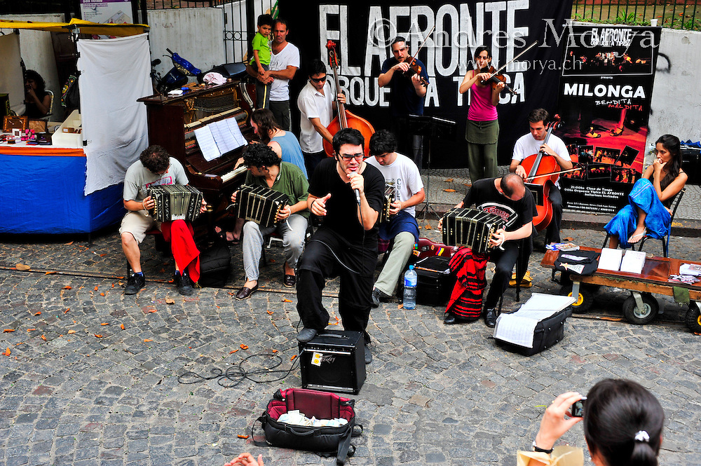 Tango Orchestra El Afronte playing Live in San Telmo Market, Buenos Aires, Argentina Image by Andres Morya