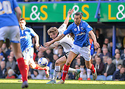 Portsmouth defender Christian Burgess denies Notts County Forward Jon Stead during the Sky Bet League 2 match between Portsmouth and Notts County at Fratton Park, Portsmouth, England on 25 March 2016. Photo by Adam Rivers.