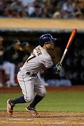 OAKLAND, CA - JULY 19:  Jose Altuve #27 of the Houston Astros hits a triple against the Oakland Athletics during the fifth inning at the Oakland Coliseum on July 19, 2016 in Oakland, California. (Photo by Jason O. Watson/Getty Images) *** Local Caption *** Jose Altuve