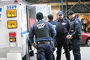New York, New York. United States. November 25th 2005..The Police emergency service unit and firefighters take care of a suspicious packet on 6th Avenue and 57th Street...